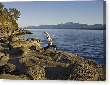 Hornby Island Canvas Print - A Woman Does Yoga At Sunset by Taylor S. Kennedy
