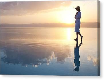 A Woman Enjoys The Warm Sun On The Edge Canvas Print by Taylor S. Kennedy