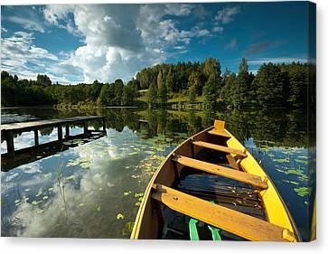 A Wooden Boat On A Lake In Suwalki Lake District Canvas Print by Slawek Staszczuk