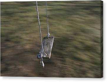 A Wooden Swing Waits For A Rider Canvas Print by Roy Gumpel