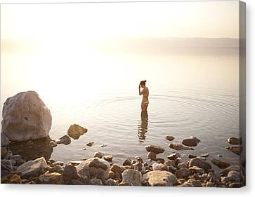 A Young Woman Wades Into The Dead Sea Canvas Print by Taylor S. Kennedy