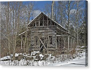 Abandoned House In Snow Canvas Print by Susan Leggett