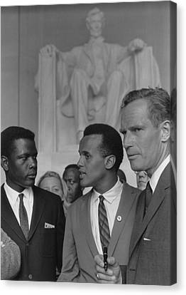 Actors Sidney Poitier, Charlton Heston Canvas Print by Everett