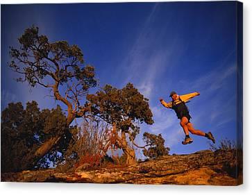 Adam Lederer Trail-runs Near Dolores Canvas Print by Bill Hatcher