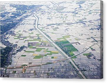 Aerial View Of Flooded Farmland Canvas Print by Jeremy Woodhouse