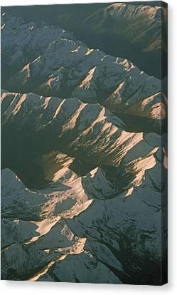 Aerial View Of Snowcapped Mountain Canvas Print by Gordon Wiltsie