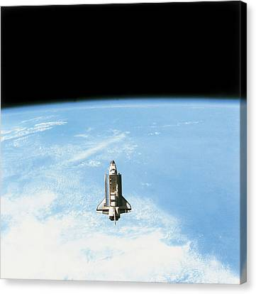 Aerial View Of The Space Shuttle In Orbit Above Earth Canvas Print by Stockbyte