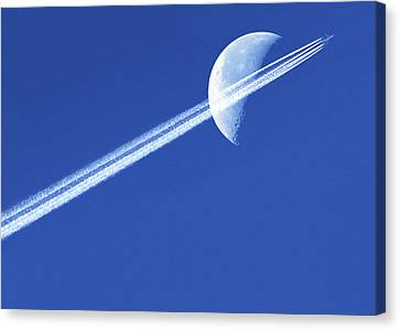 Aeroplane Contrail Against The Moon Canvas Print by Detlev Van Ravenswaay