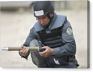 Afghan Police Student Prepares Canvas Print by Terry Moore