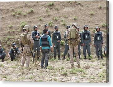 Afghan Police Students Listen To U.s Canvas Print by Terry Moore