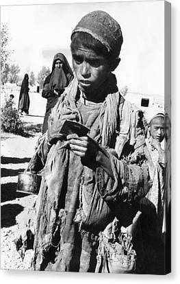 Afghan Youngster In A Unicef Feeding Canvas Print by Everett
