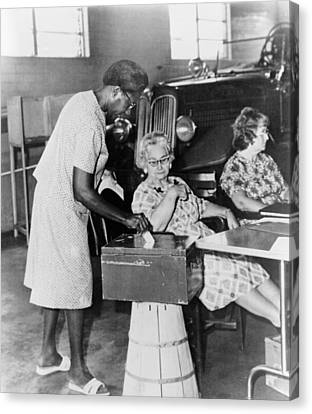 African-american Woman Placing Ballot Canvas Print by Everett