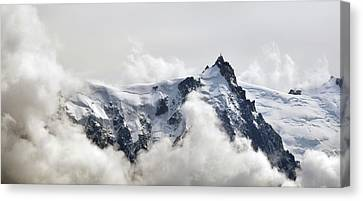 Aiguille Du Midi Out Of Clouds Canvas Print by Thomas Pollin