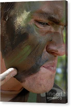Airman Applies War Paint To His Face Canvas Print by Stocktrek Images
