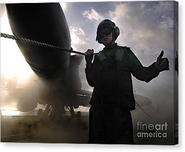 Airman Holds Up The Safety Shot Line Canvas Print by Stocktrek Images