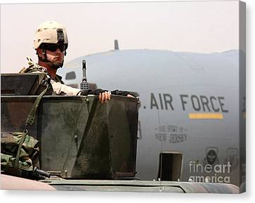 Baghdad Canvas Print - Airman Mans The Turret Atop A Humvee by Stocktrek Images