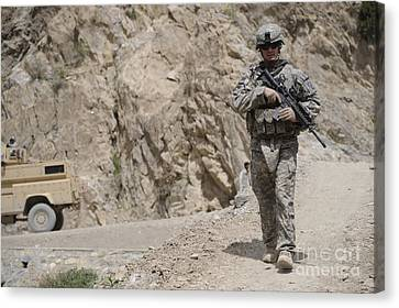 Airman Provides Security During Combat Canvas Print by Stocktrek Images