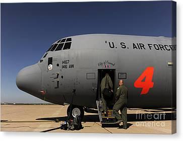 Airmen Board A C-130j Hercules At Dyess Canvas Print by Stocktrek Images