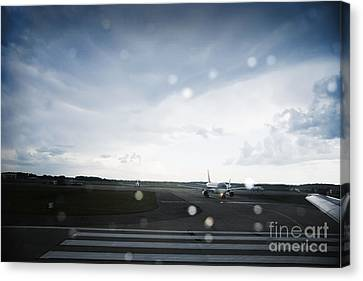 Airplane On Runway Canvas Print by Shannon Fagan