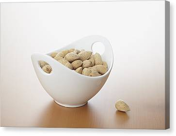 Almonds In Bowl Canvas Print by Bruce Law