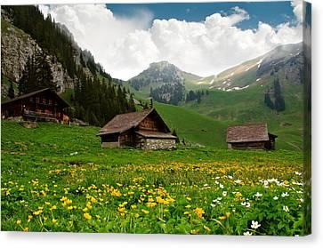 Alpine Huts - Switzerland Canvas Print by Kitty Bern