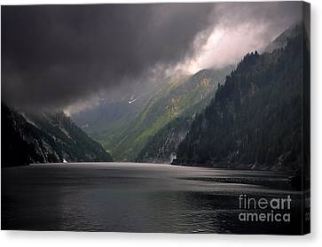 Alpine Lake With Sunlight Canvas Print by Mats Silvan
