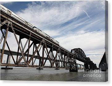 Amtrak Train Riding Atop The Benicia-martinez Train Bridge In California - 5d18723 Canvas Print by Wingsdomain Art and Photography