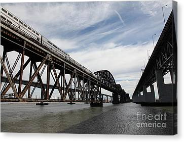 Amtrak Train Riding Atop The Benicia-martinez Train Bridge In California - 5d18727 Canvas Print by Wingsdomain Art and Photography