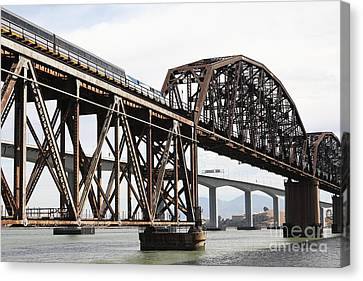 Amtrak Train Riding Atop The Benicia-martinez Train Bridge In California - 5d18768 Canvas Print by Wingsdomain Art and Photography