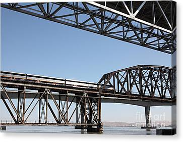 Amtrak Train Riding Atop The Benicia-martinez Train Bridge In California - 5d18835 Canvas Print by Wingsdomain Art and Photography