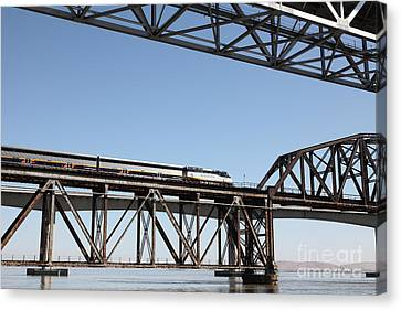 Amtrak Train Riding Atop The Benicia-martinez Train Bridge In California - 5d18837 Canvas Print by Wingsdomain Art and Photography