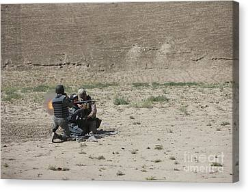 An Afghan Police Studen Fires Canvas Print by Terry Moore