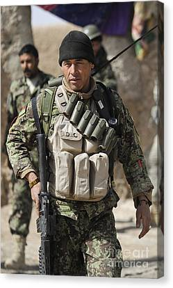 An Afghan Soldier Provides Security Canvas Print by Stocktrek Images