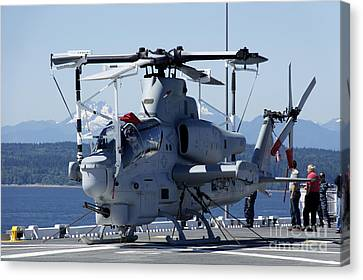 An Ah-1w Cobra Is Chained To The Flight Canvas Print by Stocktrek Images
