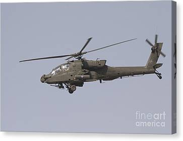 An Ah-64 Apache In Flight Canvas Print by Terry Moore