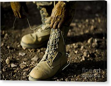 Tying Shoe Canvas Print - An Air Force Basic Military Training by Stocktrek Images