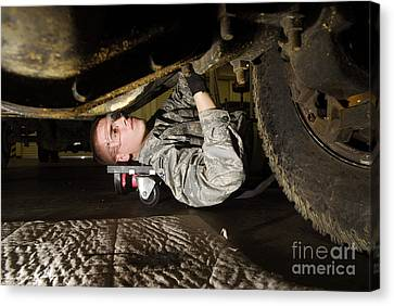 An Airman Inspects The Undercarriage Canvas Print by Stocktrek Images