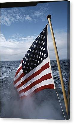 An American Flag Flutters From The Back Canvas Print by Sam Abell