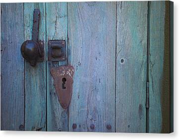 Turquoise And Rust Canvas Print - An Antique Lock On A by Raul Touzon