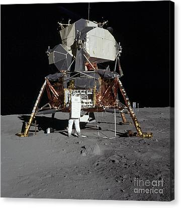 An Apollo 11 Astronaut In Front Canvas Print by Stocktrek Images
