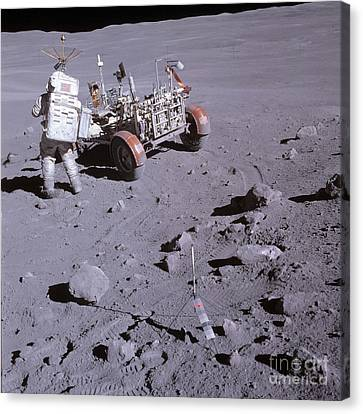 An Astronaut And A Lunar Roving Vehicle Canvas Print by Stocktrek Images