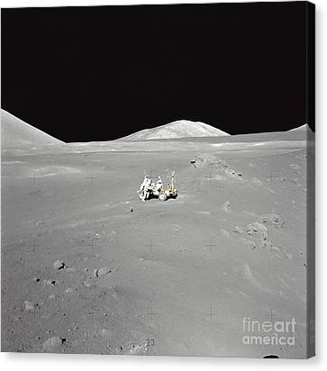 An Astronaut Working At The Lunar Canvas Print by Stocktrek Images