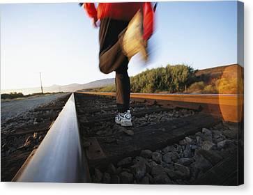 An Athlete Runs On Railroad Tracks Canvas Print by Joy Tessman