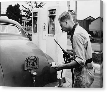 An Automobile Service Station Attendant Canvas Print by Everett