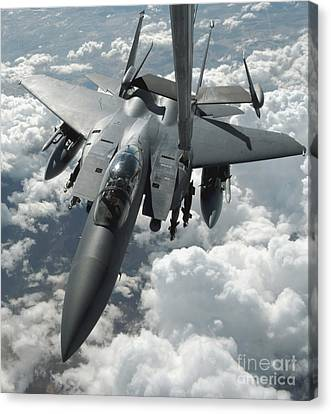 An F-15 E Strike Eagle Receives Fuel Canvas Print by Stocktrek Images
