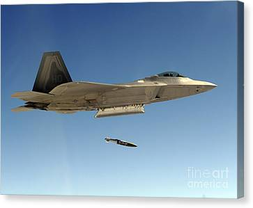 An F-22a Raptor Drops A Gbu-32 Bomb Canvas Print by Stocktrek Images