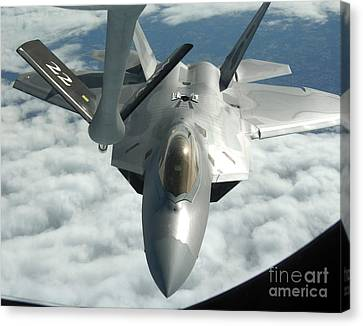An F-22a Raptor Refuels With A Kc-135 Canvas Print by Stocktrek Images