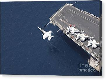 An Fa-18 Hornet Flys Over Aircraft Canvas Print by Stocktrek Images