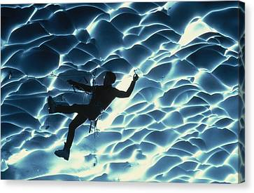 An Ice Climber Crosses The Ceiling Canvas Print by Carsten Peter
