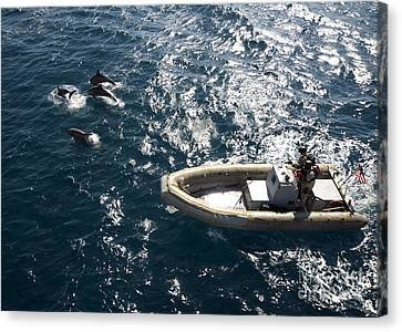 An Inflatable Boat Travels Alongside Canvas Print by Stocktrek Images
